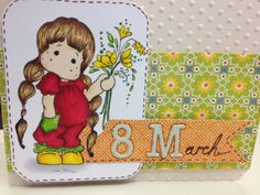 Tilda with pocket, spring copic colored handmade card.
