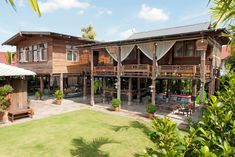 Thai wooden house with raised floors Renovated and decorated with antique furniture from the grandparents model - style house Modern Tropical House, Tropical House Design, Tropical Houses, Tiny House, Rest House, House In The Woods, Village House Design, Village Houses, Townhouse Exterior