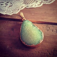 Large Green Druzy Agate Pendant in brass Gemstone jewelry supplies. $15.00, via Etsy.