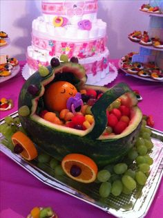 Fruit basket for baby shower that looks like bassinet made out a watermelon with orange wheels and filled with strawberries and grapes.Watermelon carved into baby stroller.Cute baby shower idea Kind of creepy, but differentThe simplest way to maximise you Baby Shower Cakes, Gateau Baby Shower, Baby Shower Snacks, Cute Baby Shower Ideas, Baby Shower Parties, Baby Shower Themes, Baby Shower Decorations, Shower Party, Baby Showers