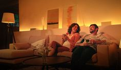 Philips Hue White Ambiance LED Starter Set with dimmer switch -With the new Hue White Am . Shelving Behind Couch, Wall Behind Couch, Coach Lights, Smart Lights, Philips Hue, Modern Couch, Starter Set, Black Image, 5 W