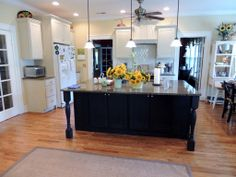 Clay painted a beautiful set of kitchen cabinets in North Chattanooga in Old Ochre with the island painted in Graphite (made to look blacker by Aubusson Blue) Chalk Paint® Decorative paint by Annie Sloan