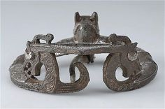Pennanular brooch - Bronze, silver and glass - Detail animal heads end knobs.  Viking.