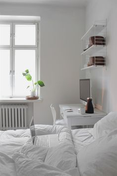 Best All White Room Ideas White Clean Bedroom Shelves Bedding 35 all-white room ideas. Discover photos of living rooms, bedrooms, kitchens, and bathrooms decorated in all white decor. Find monochrome white rooms that will inspire your own decor. Bedroom Workspace, Clean Bedroom, Shelves In Bedroom, Home Bedroom, Bedroom Decor, Bedroom Black, Master Bedroom, Bedroom Cupboards, Bedroom Simple