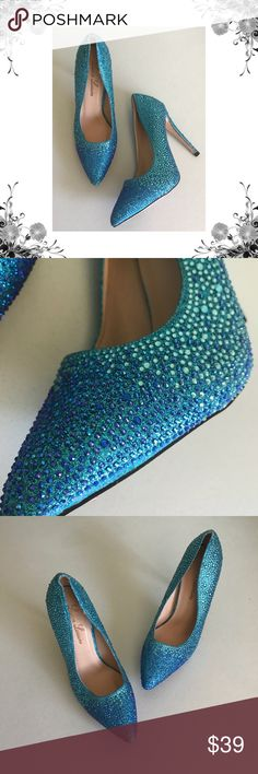 "{Lauren Lorraine} Blue Rhinestone Point Toe Heels Manufacturer Color is Blue. Pointed Toe Heels. These make the perfect ""something blue"". Heel Height is approx 4 1/4"". Platform Height is approx 1/4"". Pull On. Rhinestone Embellished. *There are a few missing rhinestones at the toe of one heel. Not super noticeable unless you're looking closely, but worth mentioning. Some sticker residue on the soles. Please see pics. Bundle for discounts! Thank you for shopping my closet! Lauren Lorraine…"