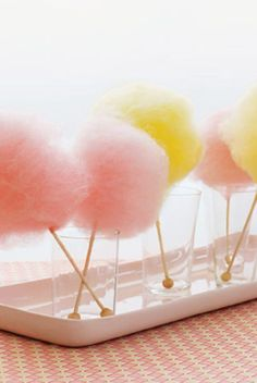 candy floss is always a show stopper! Buy in bags and then display on wooden sticks placed in tumblers.
