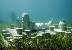 "Divers swim near Jason de Caires Taylor's ""The Man on Fire,"" one of several…"
