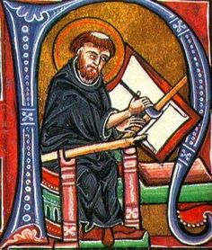 A scribe uses a ruler and knife to mark the frame that will surround his text. Colegio Santa Catalina de Bolonia.
