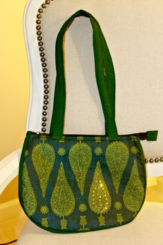 Handmade fashionable purses and bags. Dhara Bags are handmade by a female tailor workshop in India, and proceeds from sales go to providing nutritious meals to the homeless. Available here- http://www.dharabags.com. Just like the dense Indian forests, this bag is a pleasant leaf with moss green heritage Indian print on cotton cloth.