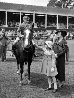 An enraptured young Elizabeth attending The Royal Windsor Horse Show in 1935—before her father was King—with her mother then the Duchess of York. From #QueenElizabeth's Royal Love of #Horses on www.AuthorAngelaBell.com.