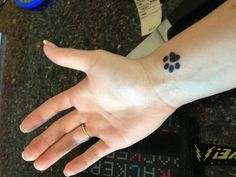 Paw print tattoo. Three of these on my ankle: each with the initials of my dogs. SWB, WBVB, SJB