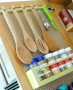 Hang your favorite utensils from a cabinet door to gain extra counter space.