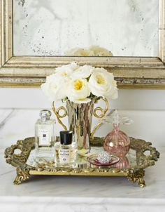 a mirrored vanity perfume tray--reminds me of a tray my mom used to have on top of her bedroom bureaus in the It was square with gold scalloped edges! Perfume Storage Ideas and Inspiration For Karen Gilbert Perfume Display, Perfume Tray, Perfume Bottles, Bathroom Vanity Tray, Gold Bathroom, Vanity Decor, Vanity Set, Feminine Bathroom, Bathroom Interior