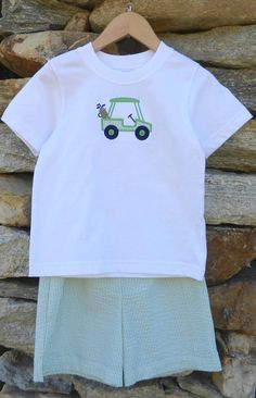 The little golfer in your life can't live without this adorable seersucker T-shirt/short set this summer! The white T features a golf cart appliqué with green and white seersucker that matches the shorts. Sizes: 2, 3, 4, 5 & 6. Was: $57 Now: $26.