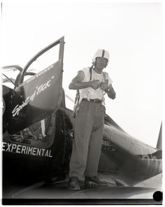 """In honor of Super Bowl 50, archivist Elizabeth Borja uncovered these images of Robert """"Bob"""" Eucker sporting a football helmet while standing atop his Bell P-63A Kingcobra. Eucker had just won the Sohio Handicap Trophy Race in the 1948 National Air Races in Cleveland, Ohio. To celebrate his $3,150 win, Eucker borrowed a football helmet from his local high school and can be seen celebrating atop his airplane """"Spirit of 'Tick'"""""""