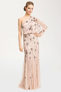 Gown by Adrianna Papell, $298 SHOP BY COLOR: I'M BLUSHING. Nude one shoulder embellished gown, by Adrianna Papell, $298