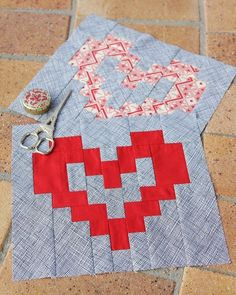 Free downloadable PDF pattern to make these heart shaped patchwork quilt blocks. Over at Bonjour Quilts