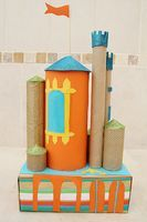 Purim is just around the corner and I'm thinking about castles — castles made out of recycled cardboard tubes and a shoebox, of course! I've always wanted to make a castle, and realized that a colorful castle crafted by mom...
