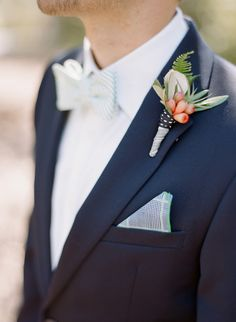 classic bow tie, boutonniere, and pocket square, photo by Josh Gruetzmacher http://ruffledblog.com/santa-rosa-winery-wedding #groom #boutonniere #wedding