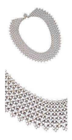 PLATINUM AND DIAMOND NECKLACE, TIFFANY & CO.  The highly flexible collar of latticework designed composed of small flowerheads set with round diamonds weighing approximately 32.00 carats, length 15½ inches, signed Tiffany & Co.