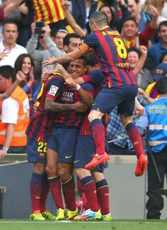 Alexis Sanchez of FC Barcelona is mobbed by team mates after scoring the opening goal during the La Liga match between FC Barcelona and Club Atletico de Madrid at Camp Nou on May 17, 2014 in Barcelona, Catalonia.