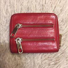 Rebecca Minkoff Red leather wallet Small wallet with zip around closure and gold hardware.  Many zipper compartments for cards and change - very useful. Used only a few times, in great condition with lots of life left! Great deep red color for all seasons! Rebecca Minkoff Bags Wallets