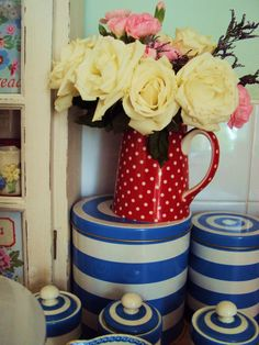 red & white polka dot jug as a vase, cute!
