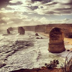 The beautiful 12 Apostles! One of the highlights of the Great Ocean Road is this collection of eerie looking rocks emerging from the Aussie coastline. These rugged rock stacks were once part of the cliffs but have been eroded over millions of years leaving this spectacular view  by alysthewildlife