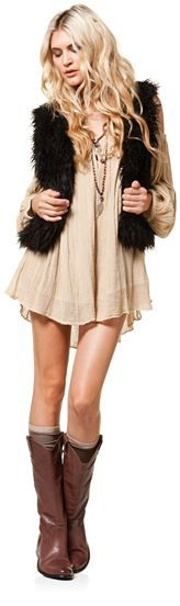 Love the styling of this outfit- fur vest over 70's inspired long sleeve dress with socks and riding boots