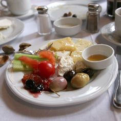 Now THAT'S a decent breakfast! :D From Turkey: olives, cucumbers, tomatoes, bread, fresh cheese, yogurt w/preserves, and nuts. Yum!