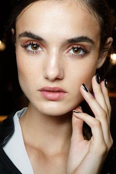 Featuring at least 20 layers of black mascara for a chunkier effect, and a delicate copper eyeshadow rubbed onto the top eyelid to be finished off with a hint of gloss, the makeup at DSquared2 was all about capturing an undone, unconstructed feel.  See more: DSquared2 Spring 2015.