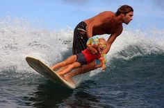Father and Daughter surfers! lol.  What an awesome Dad!