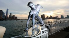 Real Life Silver Surfer Rides an Electric Surfboard Through the Streets of New York City