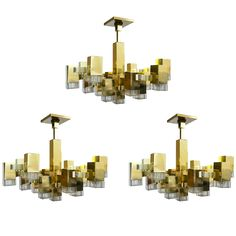 Midcentury Gold and Brass Sciolari Cube Burst Chandelier, 1960s | From a unique collection of antique and modern chandeliers and pendants  at https://www.1stdibs.com/furniture/lighting/chandeliers-pendant-lights/