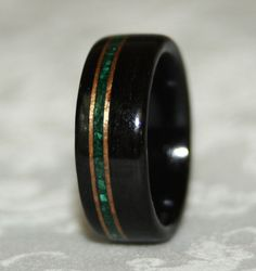 etsy seller. made from african blackwood, koa wood and crushed malachite these are so gorgeous
