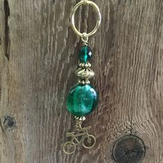 Handmade Beaded Charm Keychain/35 Emerald Green Foil Bead Swirl Silver Bead with a Bicycle Charm