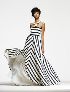 Rock a white and black striped gown to steal the show.   Shop this look on Lookastic: https://lookastic.com/women/looks/white-and-black-vertical-striped-evening-dress-white-necklace/23691   — White and Black Vertical Striped Evening Dress  — White Necklace