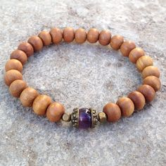 Genuine aromatic sandalwood, and an amethyst guru bead bracelet! #sandalwood #bracelet #lovepray #amethyst #wood #purple