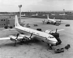 Britannia RAF Lyneham 1962, nice assortment of transport aircraft from yesteryear in the distant line up left to right, 2 Bristol Britannias, a DH Comet, a Handley Page Hastings and then another Britannia .