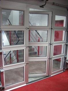 Instead of using an overhead door for an outside/inside access point you can also it within buildings themselves to create unique effects. Glass Garage Door, Garage Door Design, Garage Door Opener, Sliding Glass Door, Garage Doors, Sliding Doors, Closet Doors, Glass Doors, Transformer Un Garage