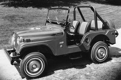 1970 Jeep CJ-5 Renegade I - complete with white wall skinny tires and vintage hubcaps
