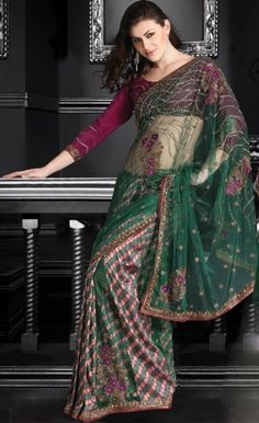 This deep green art silk and net saree with blouse.  It has been embroidered with sequins, resham, beads, stone, cutdana, patch work.  The scalloped border and pallu of the saree is simply looking superb.  Matching blouse piece is available with this saree. Starting from $320 aprox
