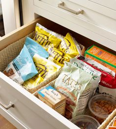 Tidy up deep kitchen drawers with removable drawer dividers, such as baskets or clear acrylic trays. Divvy up foodstuff according to type and size to ensure treats and snacks are always within easy reach./