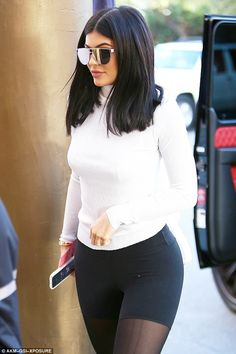 Sheer style: Kylie Jenner wore sheer black leggings as pants while meeting boyfriend Tyga in Beverly Hills on Wednesday