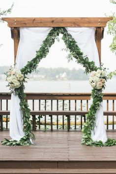 greenery eucalyptus wedding ceremony arch with flowers and fabric #green #weddingideas #wedding #dpf #deerpearlflowers See more ❤️ http://www.deerpearlflowers.com/eucalyptus-wedding-decor-ideas/