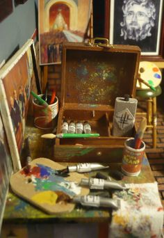 What Nathaniel has. A box of paint, brushes, and canvasses. His world is at peace with those items by his side.