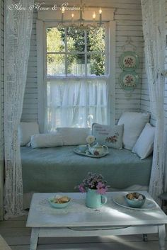 I want the chandelier & day bed on my screen porch!!