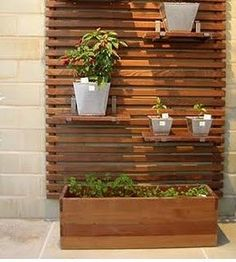 outdoor slat wall + planter boxes or shelves. Fence Planters, Planter Boxes, Privacy Planter, Vertical Planter, Outdoor Wall Planters, Pergola Planter, Outdoor Shelves, Patio Fence, Cedar Fence