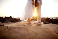 Very adorable shot of the bride and groom for the perfect location. The Beach!