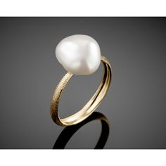 """Freshwater Pearl Ring 18 K gold ring set with a 13 X 12 mm cultured Freshwater Keshi pearl. """"Time is very slow for those who wait; very fast for those who are scared; very long for those who lament; very short for those who celebrate; but for those who love, time is eternal."""" William Shakespeare."""